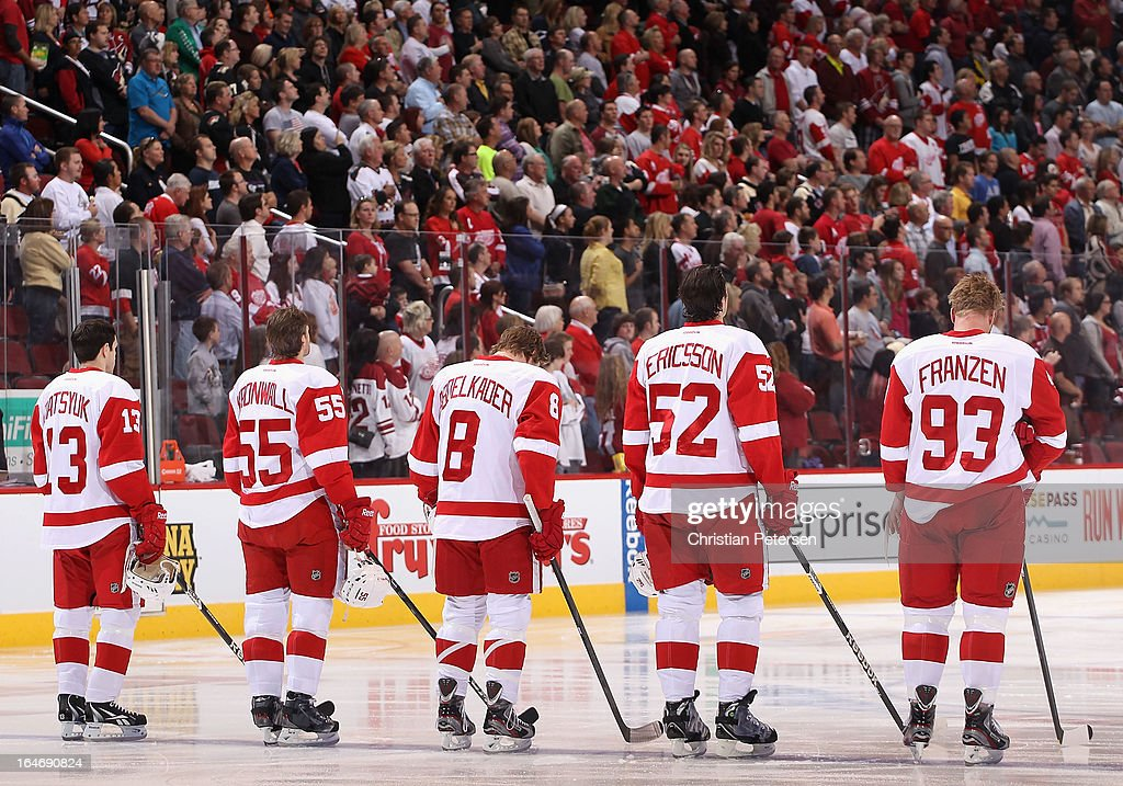 Pavel Datsyuk #13, Niklas Kronwall #55, Justin Abdelkader #8, Jonathan Ericsson #52 and Johan Franzen #93 of the Detroit Red Wings line up before the NHL game against the Phoenix Coyotes at Jobing.com Arena on March 25, 2013 in Glendale, Arizona. The Red Wings defeated the Coyotes 3-2.