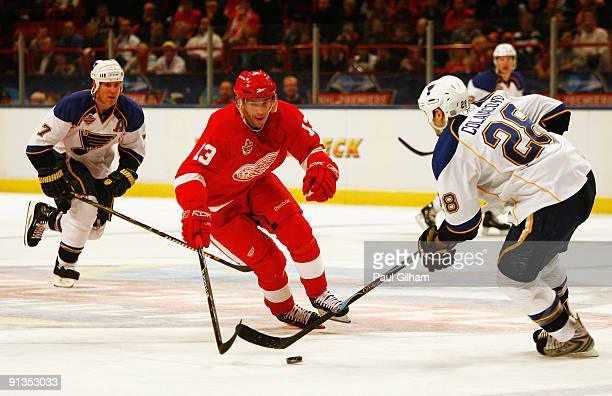 Pavel Datsyuk of Detroit Red Wings tries to evade the challenge of Carlo Colaiacovo of St Louis Blues during the 2009 Compuware NHL Premiere...