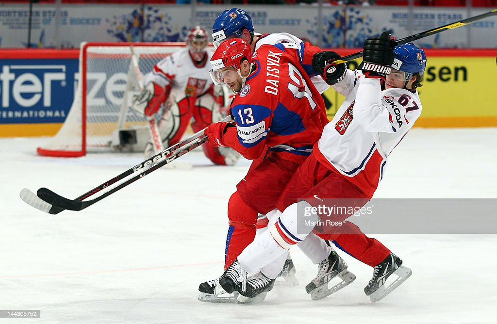 <a gi-track='captionPersonalityLinkClicked' href=/galleries/search?phrase=Pavel+Datsyuk&family=editorial&specificpeople=202893 ng-click='$event.stopPropagation()'>Pavel Datsyuk</a> (#13) of Russia and <a gi-track='captionPersonalityLinkClicked' href=/galleries/search?phrase=Michael+Frolik&family=editorial&specificpeople=537965 ng-click='$event.stopPropagation()'>Michael Frolik</a>(#67) of Czech Republic battle for the puck during the IIHF World Championship group S match between Russia and Czech Republic at Ericsson Globe on May 13, 2012 in Stockholm, Sweden.