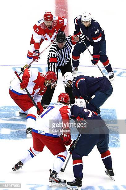 Pavel Datsyuk of Russia and Ryan Kesler of United States face off during the Men's Ice Hockey Preliminary Round Group A game on day eight of the...