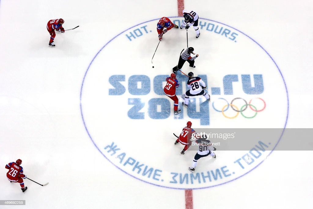 <a gi-track='captionPersonalityLinkClicked' href=/galleries/search?phrase=Pavel+Datsyuk&family=editorial&specificpeople=202893 ng-click='$event.stopPropagation()'>Pavel Datsyuk</a> #13 of Russia faces off against <a gi-track='captionPersonalityLinkClicked' href=/galleries/search?phrase=Michal+Handzus&family=editorial&specificpeople=201537 ng-click='$event.stopPropagation()'>Michal Handzus</a> #26 of Slovakia to start the Men's Ice Hockey Preliminary Round Group A game on day nine of the Sochi 2014 Winter Olympics at Bolshoy Ice Dome on February 16, 2014 in Sochi, Russia.