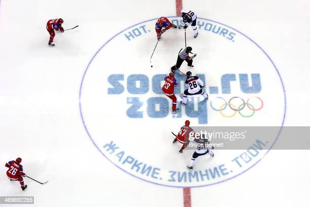 Pavel Datsyuk of Russia faces off against Michal Handzus of Slovakia to start the Men's Ice Hockey Preliminary Round Group A game on day nine of the...