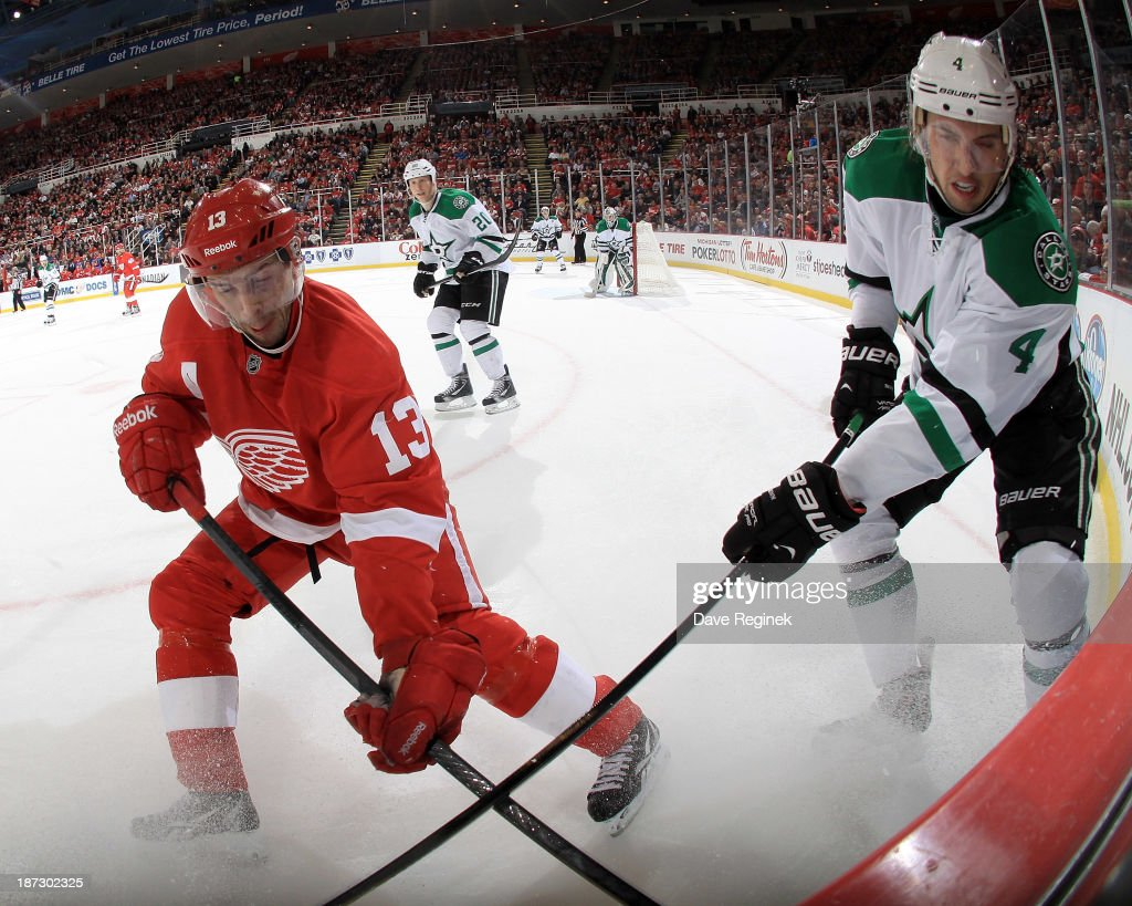 <a gi-track='captionPersonalityLinkClicked' href=/galleries/search?phrase=Pavel+Datsyuk&family=editorial&specificpeople=202893 ng-click='$event.stopPropagation()'>Pavel Datsyuk</a> #13 of the Detroit Red Wings and <a gi-track='captionPersonalityLinkClicked' href=/galleries/search?phrase=Brenden+Dillon&family=editorial&specificpeople=6254216 ng-click='$event.stopPropagation()'>Brenden Dillon</a> #4 of the Dallas Stars battle for the puck in the corner during an NHL game at Joe Louis Arena on November 7, 2013 in Detroit, Michigan. Dallas defeated Detroit 4-3 in OT