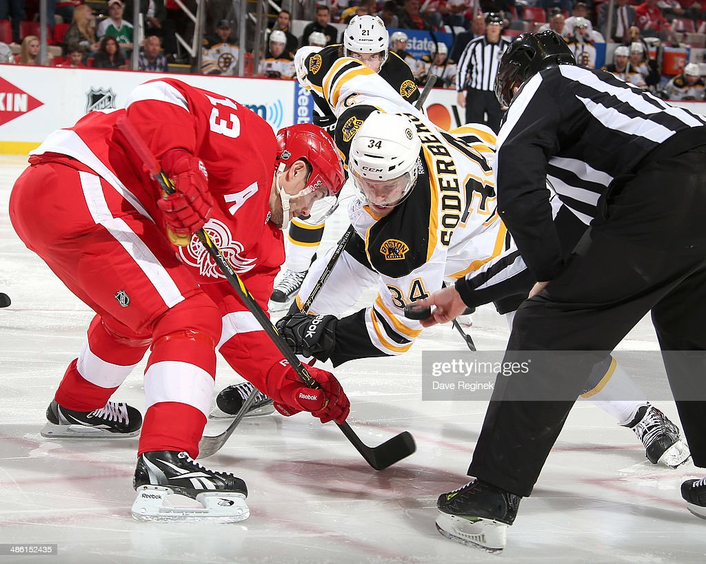 Pavel Datsyuk #13 of the Detroit Red Wings and Carl Soderberg #34 of the Boston Bruins face-off during Game Three of the First Round of the 2014 Stanley Cup Playoffs on April 22, 2014 at Joe Louis Arena in Detroit, Michigan.