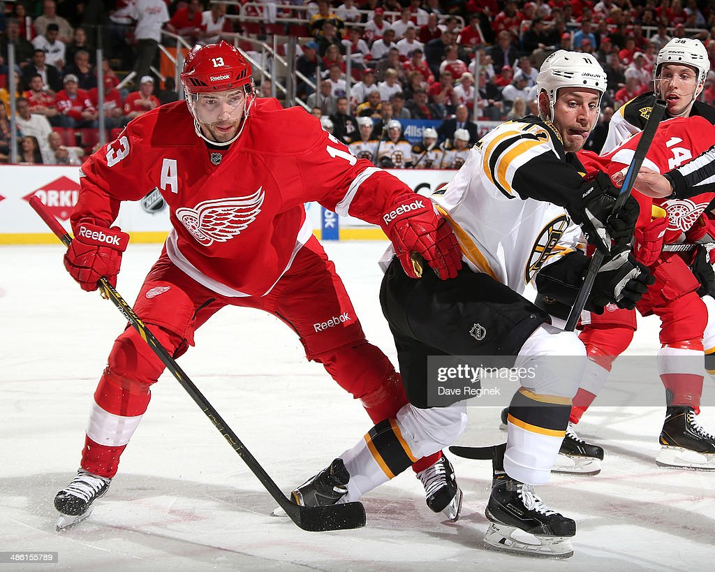 Pavel Datsyuk #13 of the Detroit Red Wings and Gregory Campbell #11 of the Boston Bruins tie up after a face-off during Game Three of the First Round of the 2014 Stanley Cup Playoffs on April 22, 2014 at Joe Louis Arena in Detroit, Michigan.