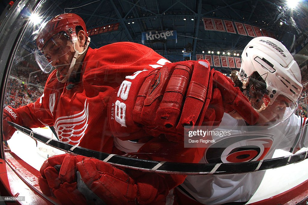 <a gi-track='captionPersonalityLinkClicked' href=/galleries/search?phrase=Pavel+Datsyuk&family=editorial&specificpeople=202893 ng-click='$event.stopPropagation()'>Pavel Datsyuk</a> #13 of the Detroit Red Wings and Justin Faulk #27 of the Carolina Hurricanes battle along the boards during an NHL game on April 11, 2014 at Joe Louis Arena in Detroit, Michigan. Carolina defeated Detroit 2-1