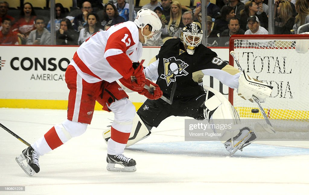 <a gi-track='captionPersonalityLinkClicked' href=/galleries/search?phrase=Pavel+Datsyuk&family=editorial&specificpeople=202893 ng-click='$event.stopPropagation()'>Pavel Datsyuk</a> #13 of the Detroit Red Wings backhands a shot past <a gi-track='captionPersonalityLinkClicked' href=/galleries/search?phrase=Tomas+Vokoun&family=editorial&specificpeople=202179 ng-click='$event.stopPropagation()'>Tomas Vokoun</a> # 92 of the Pittsburgh Penguins for a goal during the second period of a preseason game on September 16, 2013 at the CONSOL Energy Center in Pittsburgh, Pennsylvania.