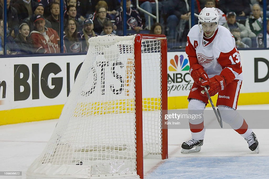 <a gi-track='captionPersonalityLinkClicked' href=/galleries/search?phrase=Pavel+Datsyuk&family=editorial&specificpeople=202893 ng-click='$event.stopPropagation()'>Pavel Datsyuk</a> #13 of the Detroit Red Wings beats <a gi-track='captionPersonalityLinkClicked' href=/galleries/search?phrase=Sergei+Bobrovsky&family=editorial&specificpeople=4488556 ng-click='$event.stopPropagation()'>Sergei Bobrovsky</a> #72 of the Columbus Blue Jackets to score the game tying goal during the third period on January 21, 2013 at Nationwide Arena in Columbus, Ohio. Detroit defeated Columbus 4-3 in a shootout.