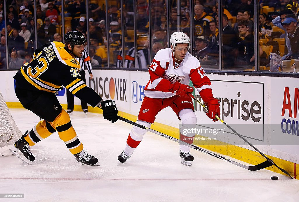 Pavel Datsyuk #13 of the Detroit Red Wings carries the puck around the net in the second period in front of Zdeno Chara #33 of the Boston Bruins in Game One of the First Round of the 2014 NHL Stanley Cup Playoffs at TD Garden on April 18, 2014 in Boston, Massachusetts.