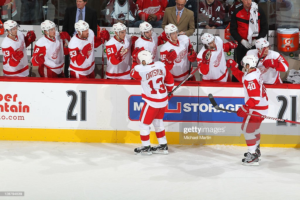 <a gi-track='captionPersonalityLinkClicked' href=/galleries/search?phrase=Pavel+Datsyuk&family=editorial&specificpeople=202893 ng-click='$event.stopPropagation()'>Pavel Datsyuk</a> #13 of the Detroit Red Wings celebrates a goal against the Colorado Avalanche at the Pepsi Center on October 8, 2011 in Denver, Colorado. Detroit beat Colorado 3-0.