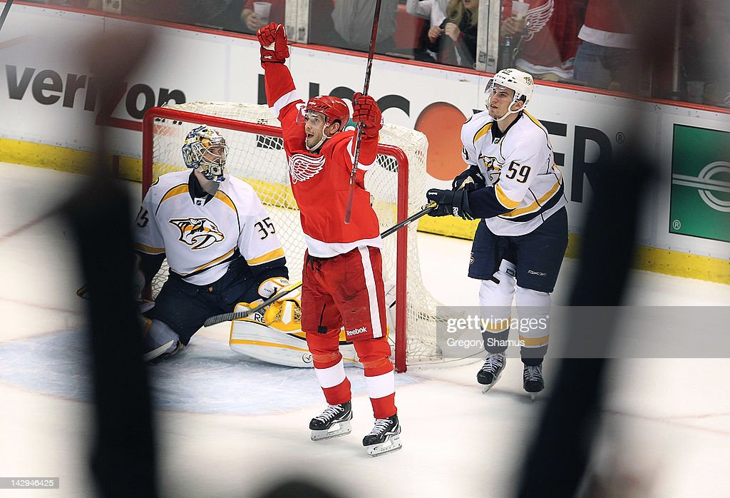 <a gi-track='captionPersonalityLinkClicked' href=/galleries/search?phrase=Pavel+Datsyuk&family=editorial&specificpeople=202893 ng-click='$event.stopPropagation()'>Pavel Datsyuk</a> #13 of the Detroit Red Wings celebrates a second period goal in front of <a gi-track='captionPersonalityLinkClicked' href=/galleries/search?phrase=Pekka+Rinne&family=editorial&specificpeople=2118342 ng-click='$event.stopPropagation()'>Pekka Rinne</a> #35 and <a gi-track='captionPersonalityLinkClicked' href=/galleries/search?phrase=Roman+Josi&family=editorial&specificpeople=4247871 ng-click='$event.stopPropagation()'>Roman Josi</a> #59 of the Nashville Predators during Game Three of the Western Conference Quarterfinals during the 2012 NHL Stanley Cup Playoffs at Joe Louis Arena on April 15, 2012 in Detroit, Michigan. Nashville won the game 3-2 and lead the series 2-1.