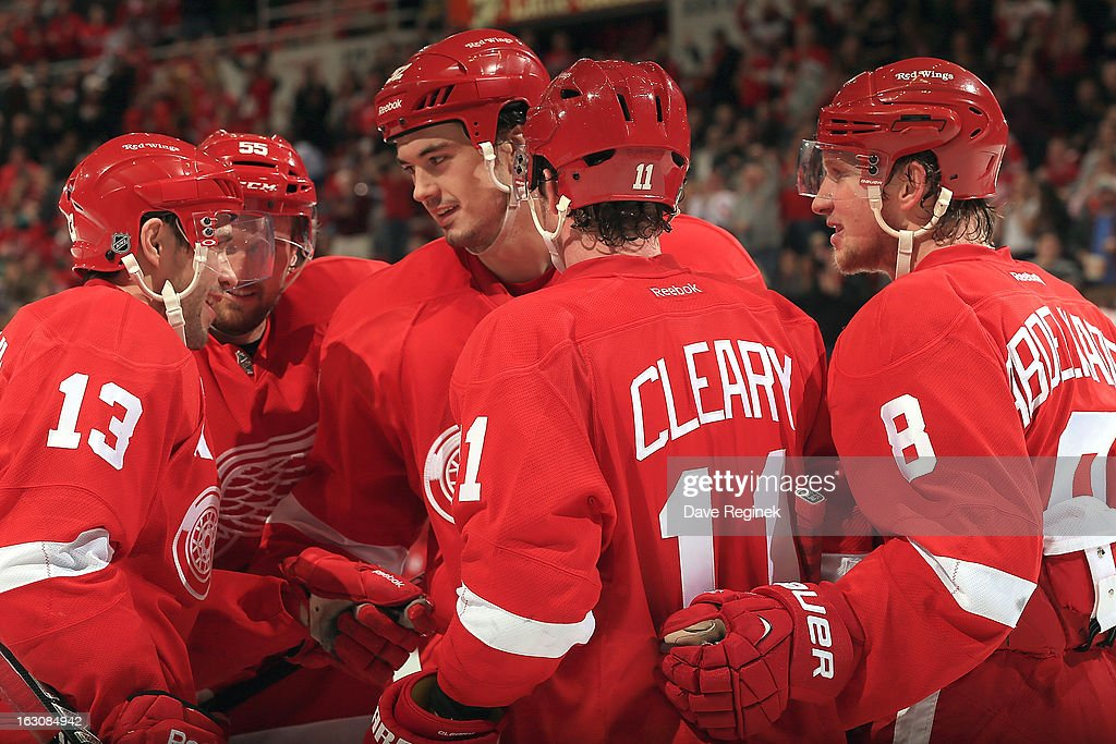 Pavel Datsyuk #13 of the Detroit Red Wings celebrates his goal with teamates Dan Cleary #11, Jonathan Ericsson #52, Niklas Kronwall #55 and Justin Abdelkader #8 during a NHL game against the the Vancouver Canucks at Joe Louis Arena on February 24, 2013 in Detroit, Michigan. The Wings won 8-3