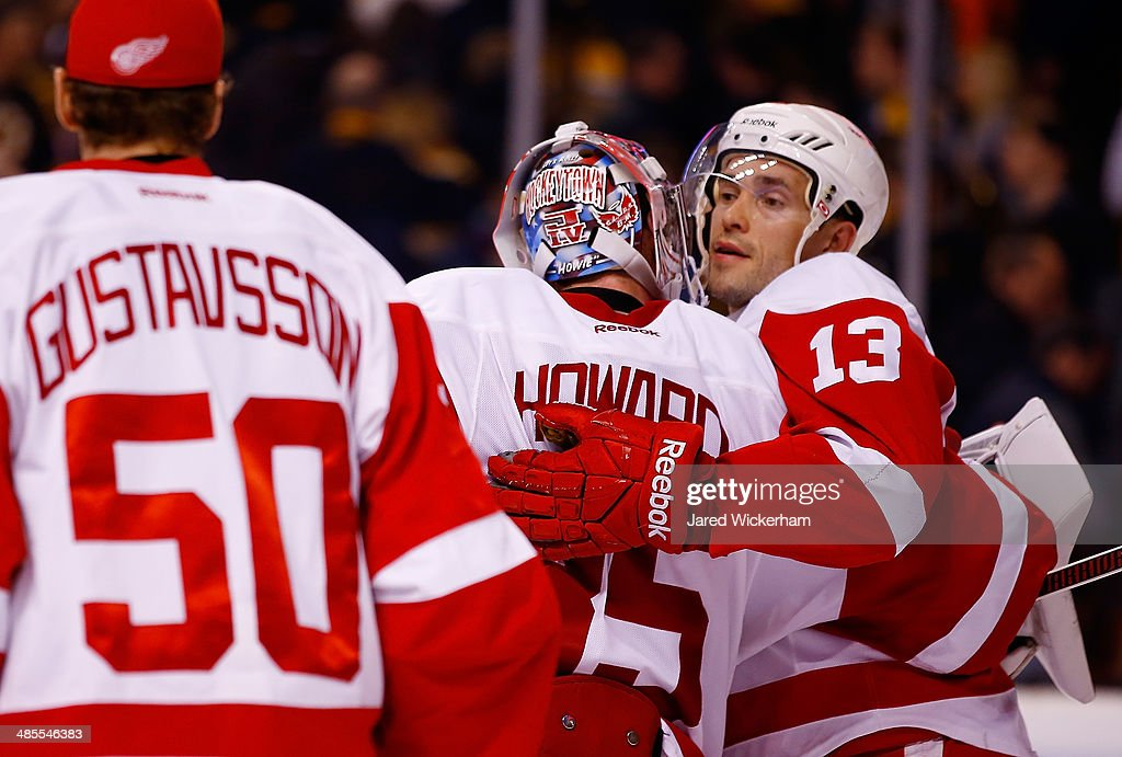 Pavel Datsyuk #13 of the Detroit Red Wings celebrates their 1-0 win against the Boston Bruins with teammate Jimmy Howard #35 in Game One of the First Round of the 2014 NHL Stanley Cup Playoffs at TD Garden on April 18, 2014 in Boston, Massachusetts.
