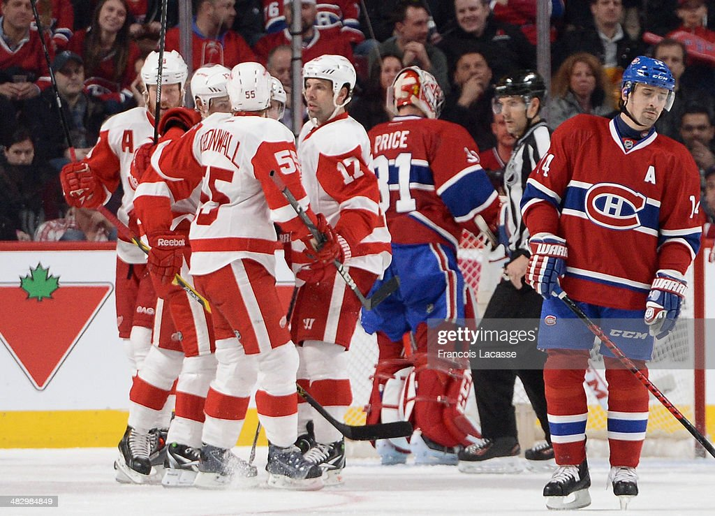 <a gi-track='captionPersonalityLinkClicked' href=/galleries/search?phrase=Pavel+Datsyuk&family=editorial&specificpeople=202893 ng-click='$event.stopPropagation()'>Pavel Datsyuk</a> #13 of the Detroit Red Wings celebrates with teammates <a gi-track='captionPersonalityLinkClicked' href=/galleries/search?phrase=Niklas+Kronwall&family=editorial&specificpeople=220826 ng-click='$event.stopPropagation()'>Niklas Kronwall</a> #55, <a gi-track='captionPersonalityLinkClicked' href=/galleries/search?phrase=David+Legwand&family=editorial&specificpeople=202553 ng-click='$event.stopPropagation()'>David Legwand</a> #17 and <a gi-track='captionPersonalityLinkClicked' href=/galleries/search?phrase=Johan+Franzen&family=editorial&specificpeople=624356 ng-click='$event.stopPropagation()'>Johan Franzen</a> #93 after scoring a goal against the Montreal Canadiens during the NHL game on April 5, 2014 at the Bell Centre in Montreal, Quebec, Canada.