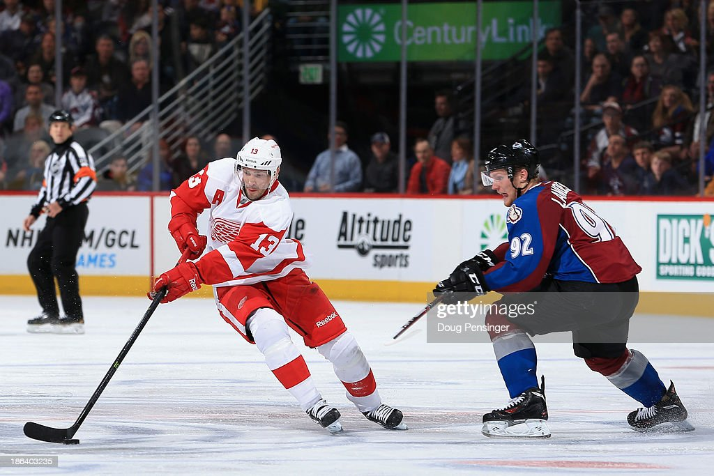 <a gi-track='captionPersonalityLinkClicked' href=/galleries/search?phrase=Pavel+Datsyuk&family=editorial&specificpeople=202893 ng-click='$event.stopPropagation()'>Pavel Datsyuk</a> #13 of the Detroit Red Wings controls the puck against <a gi-track='captionPersonalityLinkClicked' href=/galleries/search?phrase=Gabriel+Landeskog&family=editorial&specificpeople=6590816 ng-click='$event.stopPropagation()'>Gabriel Landeskog</a> #92 of the Colorado Avalanche at Pepsi Center on October 17, 2013 in Denver, Colorado.