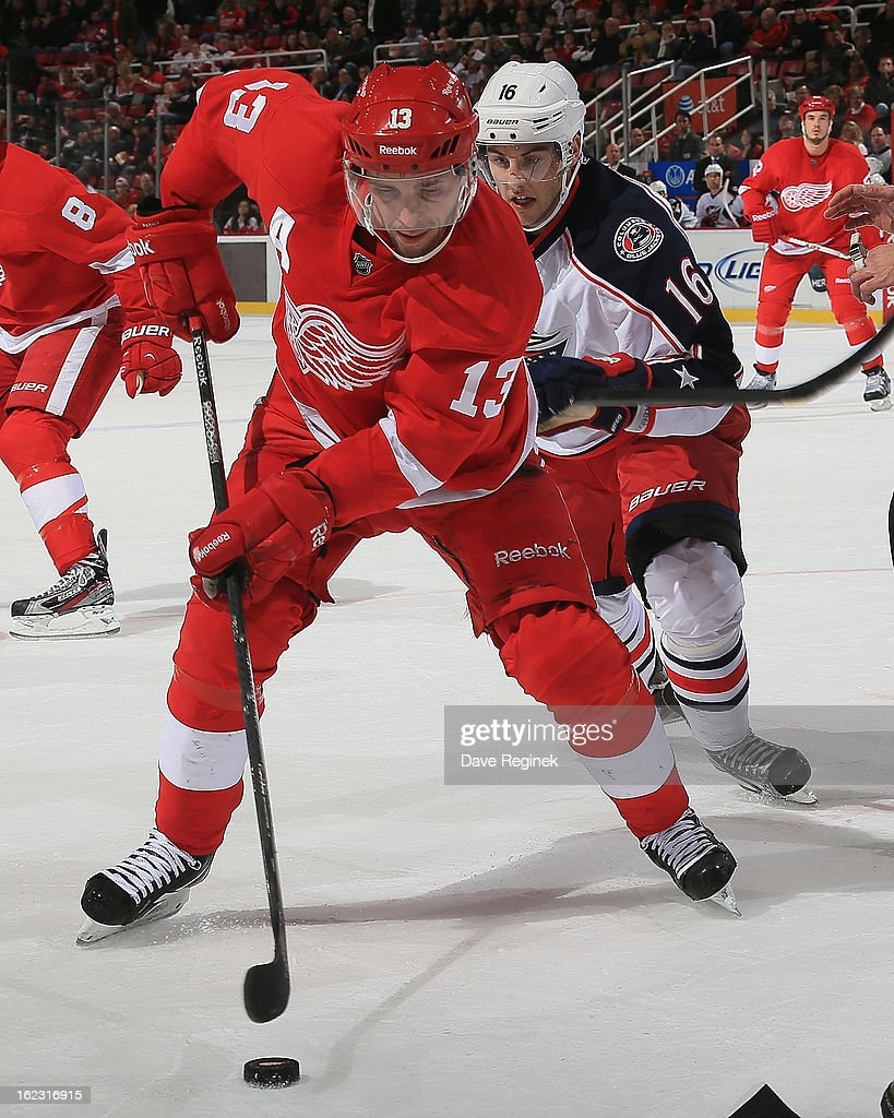 <a gi-track='captionPersonalityLinkClicked' href=/galleries/search?phrase=Pavel+Datsyuk&family=editorial&specificpeople=202893 ng-click='$event.stopPropagation()'>Pavel Datsyuk</a> #13 of the Detroit Red Wings controls the puck in front of <a gi-track='captionPersonalityLinkClicked' href=/galleries/search?phrase=Derick+Brassard&family=editorial&specificpeople=540468 ng-click='$event.stopPropagation()'>Derick Brassard</a> #16 of the Columbus Blue Jackets during a NHL game at Joe Louis Arena on February 21, 2013 in Detroit, Michigan.