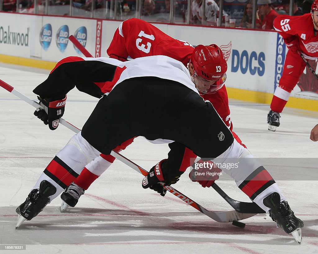 <a gi-track='captionPersonalityLinkClicked' href=/galleries/search?phrase=Pavel+Datsyuk&family=editorial&specificpeople=202893 ng-click='$event.stopPropagation()'>Pavel Datsyuk</a> #13 of the Detroit Red Wings faces off against <a gi-track='captionPersonalityLinkClicked' href=/galleries/search?phrase=Jason+Spezza&family=editorial&specificpeople=202023 ng-click='$event.stopPropagation()'>Jason Spezza</a> #19 of the Ottawa Senators during an NHL game at Joe Louis Arena on October 23, 2013 in Detroit, Michigan. The Senators win 6-1