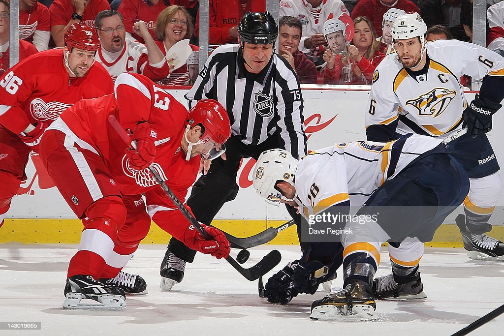 <a gi-track='captionPersonalityLinkClicked' href=/galleries/search?phrase=Pavel+Datsyuk&family=editorial&specificpeople=202893 ng-click='$event.stopPropagation()'>Pavel Datsyuk</a> #13 of the Detroit Red Wings faces off with <a gi-track='captionPersonalityLinkClicked' href=/galleries/search?phrase=Paul+Gaustad&family=editorial&specificpeople=577980 ng-click='$event.stopPropagation()'>Paul Gaustad</a> #28 of the Nashville Predators in Game Four of the Western Conference Quarterfinals during the 2012 NHL Stanley Cup Playoffs at Joe Louis Arena on April 17, 2012 in Detroit, Michigan.