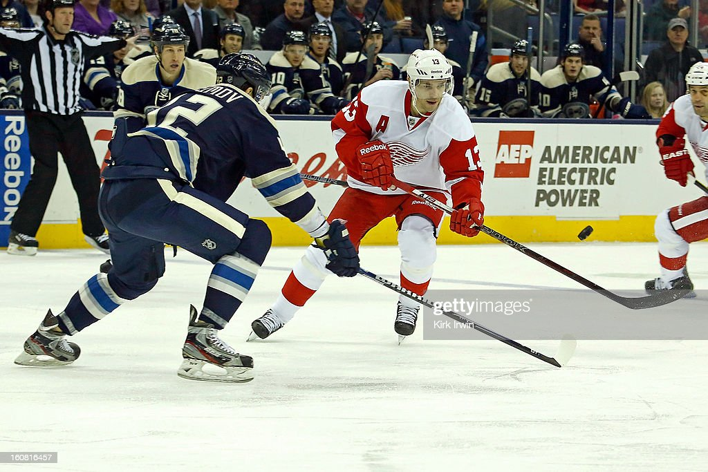 Pavel Datsyuk #13 of the Detroit Red Wings flips the puck past Artem Ansimov #42 of the Columbus Blue Jackets on February 2, 2013 at Nationwide Arena in Columbus, Ohio.