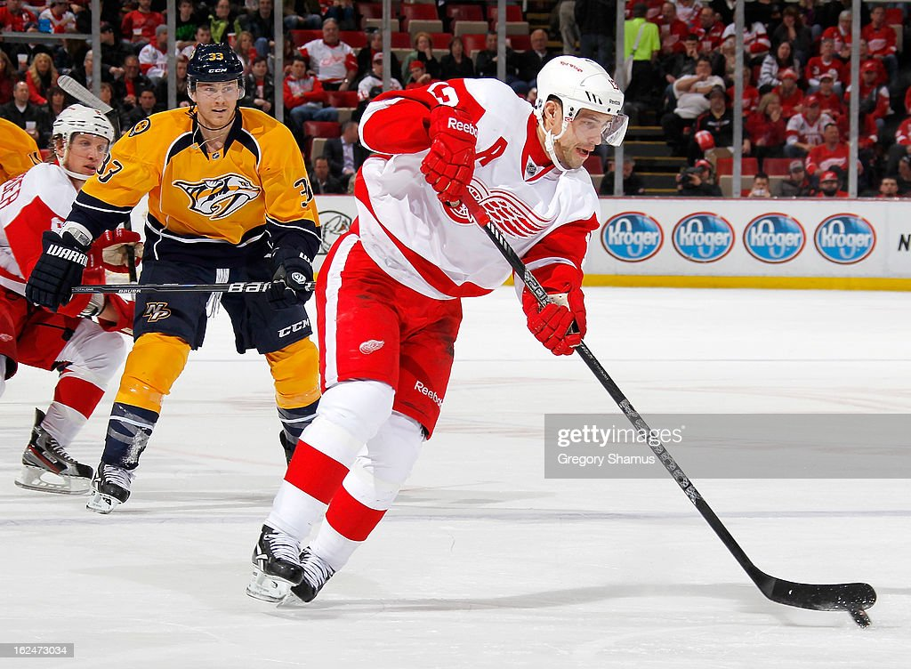 <a gi-track='captionPersonalityLinkClicked' href=/galleries/search?phrase=Pavel+Datsyuk&family=editorial&specificpeople=202893 ng-click='$event.stopPropagation()'>Pavel Datsyuk</a> #13 of the Detroit Red Wings heads up ice in front of Colin Wilson #33 of the Nashville Predators during the third period at Joe Louis Arena on February 23, 2013 in Detroit, Michigan. Detroit won the game 4-0.