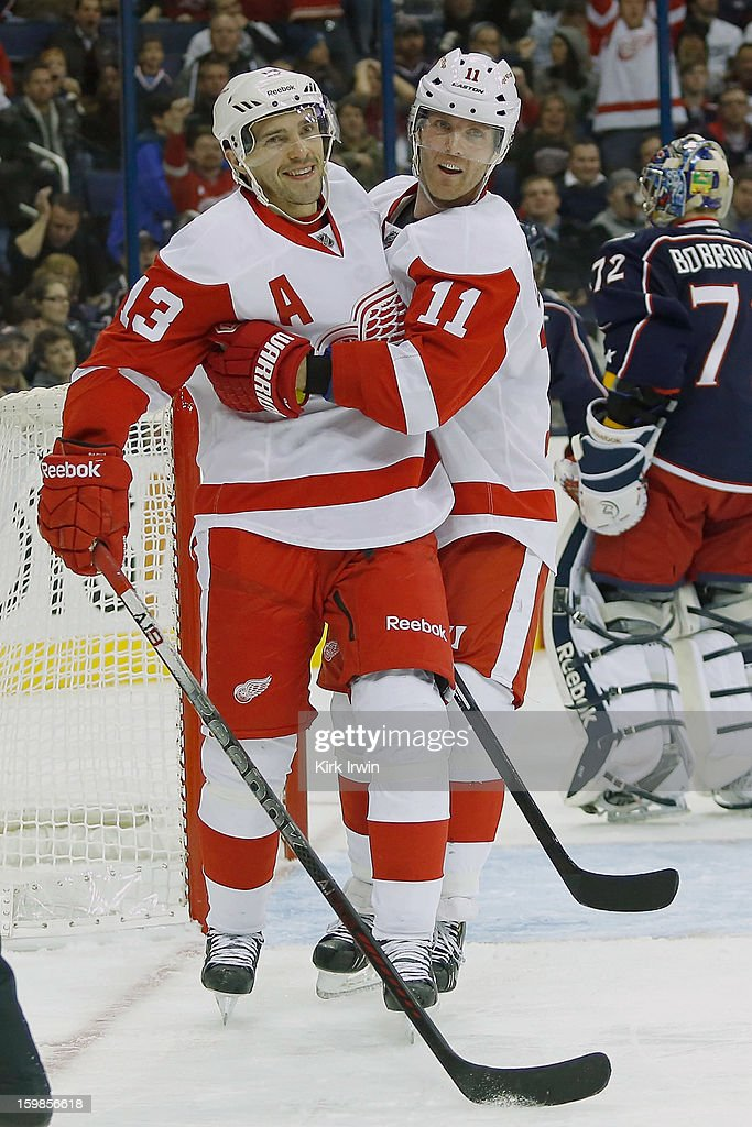 <a gi-track='captionPersonalityLinkClicked' href=/galleries/search?phrase=Pavel+Datsyuk&family=editorial&specificpeople=202893 ng-click='$event.stopPropagation()'>Pavel Datsyuk</a> #13 of the Detroit Red Wings is congratulated by <a gi-track='captionPersonalityLinkClicked' href=/galleries/search?phrase=Daniel+Cleary&family=editorial&specificpeople=220490 ng-click='$event.stopPropagation()'>Daniel Cleary</a> #11 of the Detroit Red Wings after scoring the game tying goal during the third period against the Columbus Blue Jackets on January 21, 2013 at Nationwide Arena in Columbus, Ohio. Detroit defeated Columbus 4-3 in a shootout.