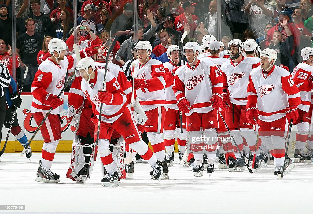 Pavel Datsyuk #13 of the Detroit Red Wings is congratulated by teammates as he skates off the ice after scoring the winning goal in overtime against the Colorado Avalanche at the Pepsi Center on April 5, 2013 in Denver, Colorado. Detroit beat Colorado 3-2 in overtime.