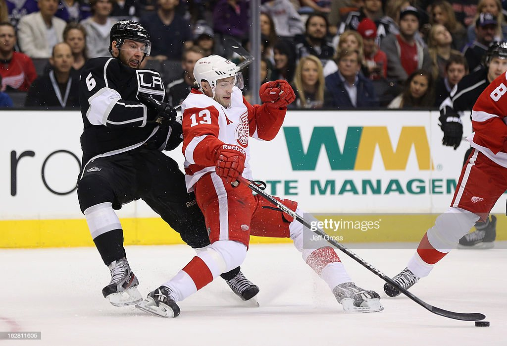 <a gi-track='captionPersonalityLinkClicked' href=/galleries/search?phrase=Pavel+Datsyuk&family=editorial&specificpeople=202893 ng-click='$event.stopPropagation()'>Pavel Datsyuk</a> #13 of the Detroit Red Wings is pulled down by Jake Muzzin #6 of the Los Angeles Kings in the first period at Staples Center on February 27, 2013 in Los Angeles, California. The Kings defeated the Red Wings 2-1.