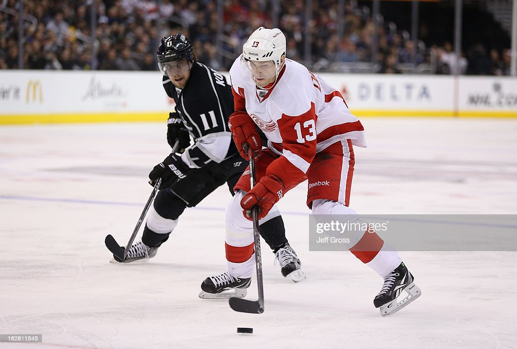 <a gi-track='captionPersonalityLinkClicked' href=/galleries/search?phrase=Pavel+Datsyuk&family=editorial&specificpeople=202893 ng-click='$event.stopPropagation()'>Pavel Datsyuk</a> #13 of the Detroit Red Wings is pursued by <a gi-track='captionPersonalityLinkClicked' href=/galleries/search?phrase=Anze+Kopitar&family=editorial&specificpeople=634911 ng-click='$event.stopPropagation()'>Anze Kopitar</a> #11 of the Los Angeles Kings for the puck in the third period at Staples Center on February 27, 2013 in Los Angeles, California. The Kings defeated the Red Wings 2-1.