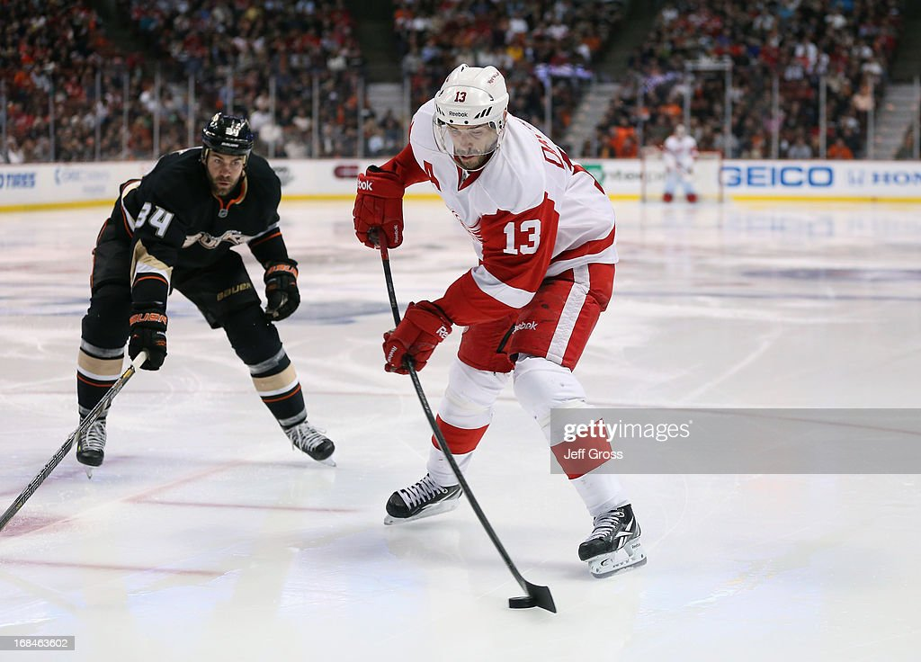 Pavel Datsyuk #13 of the Detroit Red Wings is pursued by Daniel Winnik #34 of the Anaheim Ducks in Game Five of the Western Conference Quarterfinals during the 2013 NHL Stanley Cup Playoffs at Honda Center on May 8, 2013 in Anaheim, California.