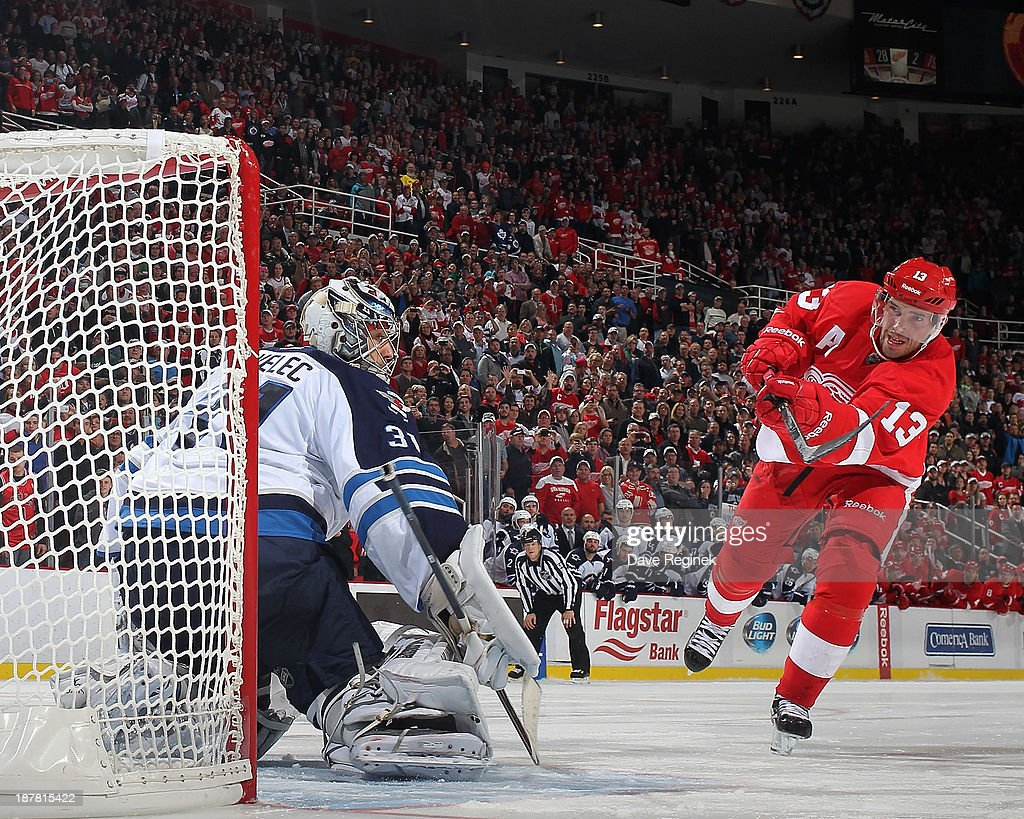 Pavel Datsyuk #13 of the Detroit Red Wings misses the net in a shootout attempt on goalie Ondrej Pavelec #31 of the Winnipeg Jets during an NHL game at Joe Louis Arena on November 12, 2013 in Detroit, Michigan. Winnipeg Jets defeated the Detroit Red Wings 3-2 in a shootout