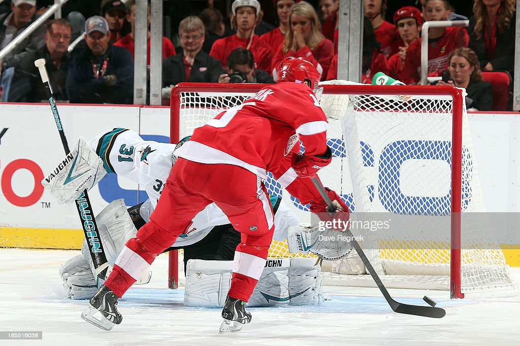 <a gi-track='captionPersonalityLinkClicked' href=/galleries/search?phrase=Pavel+Datsyuk&family=editorial&specificpeople=202893 ng-click='$event.stopPropagation()'>Pavel Datsyuk</a> #13 of the Detroit Red Wings misses the net with his shoot-out opportunity on <a gi-track='captionPersonalityLinkClicked' href=/galleries/search?phrase=Antti+Niemi&family=editorial&specificpeople=213913 ng-click='$event.stopPropagation()'>Antti Niemi</a> #31 of the San Jose Sharks during an NHL game at Joe Louis Arena on October 21, 2013 in Detroit, Michigan. San Jose Sharks win in a shoot-out 1-0