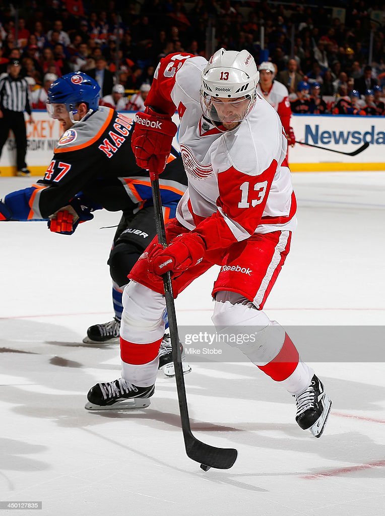 <a gi-track='captionPersonalityLinkClicked' href=/galleries/search?phrase=Pavel+Datsyuk&family=editorial&specificpeople=202893 ng-click='$event.stopPropagation()'>Pavel Datsyuk</a> #13 of the Detroit Red Wings plays the puck against New York Islanders at Nassau Veterans Memorial Coliseum on November 16, 2013 in Uniondale, New York.