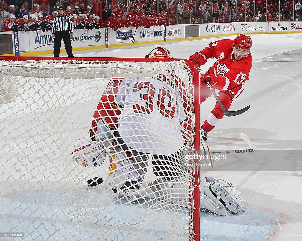 Pavel Datsyuk of the Detroit Red Wings scores a goal on Scott Clemmensen of the Florida Panthers in a shootout during an NHL game at Joe Louis Arena...