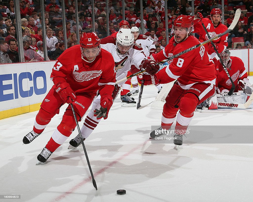 <a gi-track='captionPersonalityLinkClicked' href=/galleries/search?phrase=Pavel+Datsyuk&family=editorial&specificpeople=202893 ng-click='$event.stopPropagation()'>Pavel Datsyuk</a> #13 of the Detroit Red Wings skates out of the corner with the puck as teammate <a gi-track='captionPersonalityLinkClicked' href=/galleries/search?phrase=Justin+Abdelkader&family=editorial&specificpeople=2271858 ng-click='$event.stopPropagation()'>Justin Abdelkader</a> #8 battles for position with <a gi-track='captionPersonalityLinkClicked' href=/galleries/search?phrase=Martin+Hanzal&family=editorial&specificpeople=2109469 ng-click='$event.stopPropagation()'>Martin Hanzal</a> #11 of the Phoenix Coyotes during a NHL game at Joe Louis Arena on October 10, 2013 in Detroit, Michigan. The Coyotes won 4-2