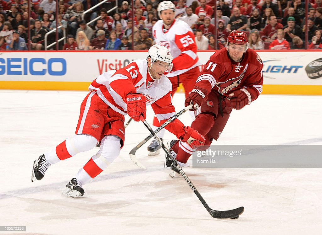 <a gi-track='captionPersonalityLinkClicked' href=/galleries/search?phrase=Pavel+Datsyuk&family=editorial&specificpeople=202893 ng-click='$event.stopPropagation()'>Pavel Datsyuk</a> #13 of the Detroit Red Wings skates with the puck past the defense of <a gi-track='captionPersonalityLinkClicked' href=/galleries/search?phrase=Martin+Hanzal&family=editorial&specificpeople=2109469 ng-click='$event.stopPropagation()'>Martin Hanzal</a> #11 of the Phoenix Coyotes during the third period at Jobing.com Arena on April 4, 2013 in Glendale, Arizona.
