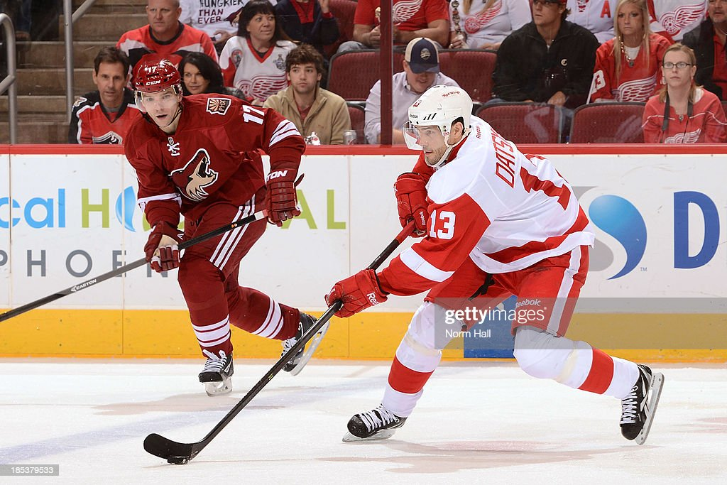 <a gi-track='captionPersonalityLinkClicked' href=/galleries/search?phrase=Pavel+Datsyuk&family=editorial&specificpeople=202893 ng-click='$event.stopPropagation()'>Pavel Datsyuk</a> #13 of the Detroit Red Wings skates with the puck while being defended by <a gi-track='captionPersonalityLinkClicked' href=/galleries/search?phrase=Radim+Vrbata&family=editorial&specificpeople=204716 ng-click='$event.stopPropagation()'>Radim Vrbata</a> #17 of the Phoenix Coyotes at Jobing.com Arena on October 19, 2013 in Glendale, Arizona.
