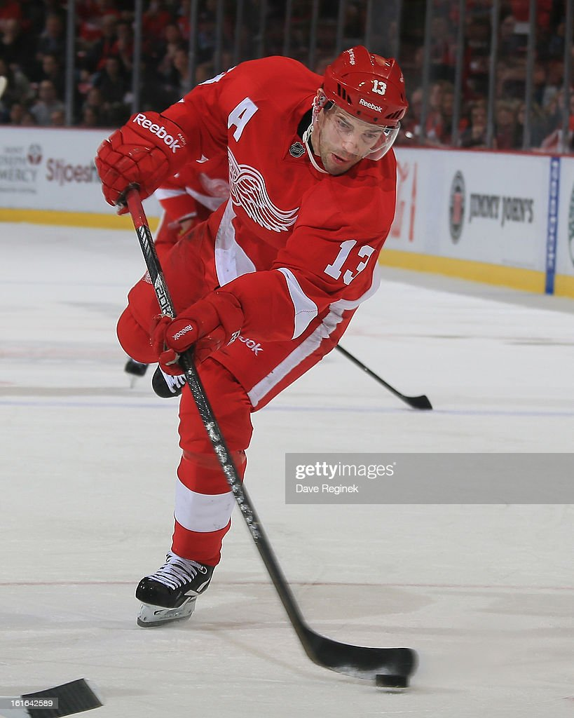 <a gi-track='captionPersonalityLinkClicked' href=/galleries/search?phrase=Pavel+Datsyuk&family=editorial&specificpeople=202893 ng-click='$event.stopPropagation()'>Pavel Datsyuk</a> #13 of the Detroit Red Wings takes a wrist shot during a NHL game against the St Louis Blues at Joe Louis Arena on February 13, 2013 in Detroit, Michigan. The Blues won 4-3