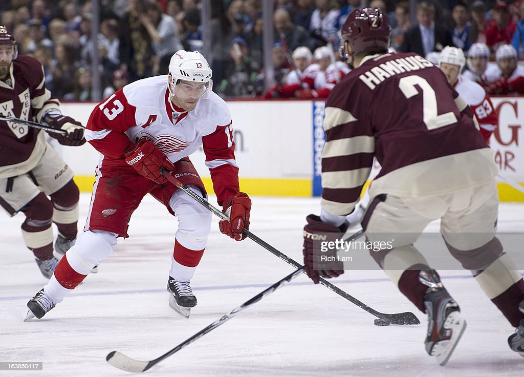 <a gi-track='captionPersonalityLinkClicked' href=/galleries/search?phrase=Pavel+Datsyuk&family=editorial&specificpeople=202893 ng-click='$event.stopPropagation()'>Pavel Datsyuk</a> #13 of the Detroit Red Wings tries to get past <a gi-track='captionPersonalityLinkClicked' href=/galleries/search?phrase=Dan+Hamhuis&family=editorial&specificpeople=204213 ng-click='$event.stopPropagation()'>Dan Hamhuis</a> #2 of the Vancouver Canucks during the first period of NHL action on March 16, 2013 at Rogers Arena in Vancouver, British Columbia, Canada.