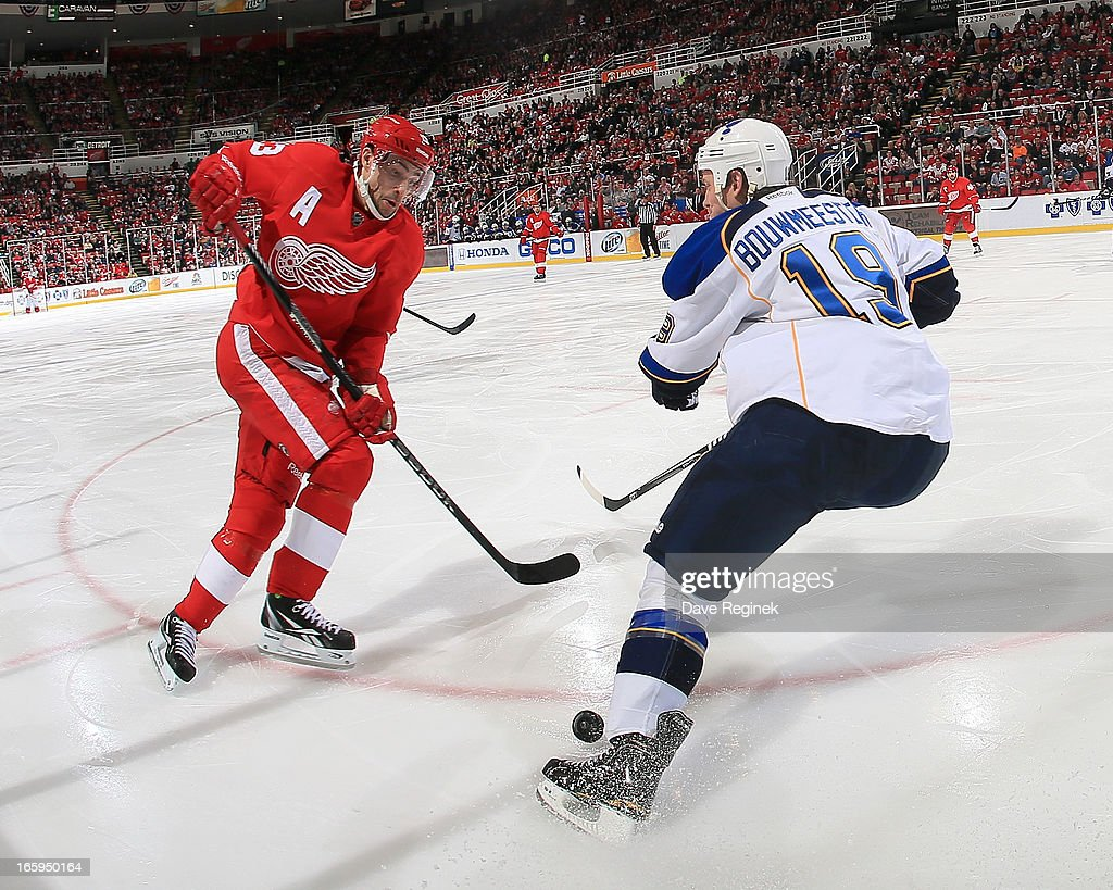 Pavel Datsyuk of the Detroit Red Wings tries to make a move on Jay Bouwmeester of the St Louis Blues but the puck ends up in his feet during a NHL...