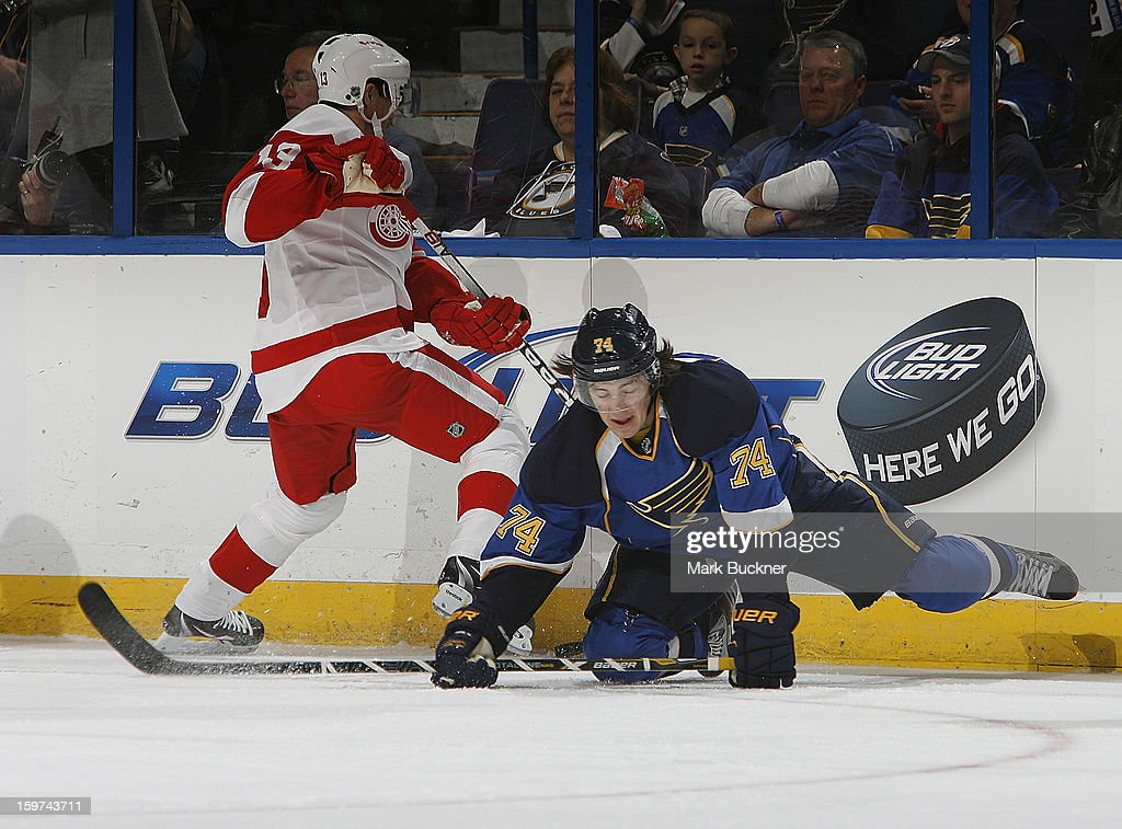 <a gi-track='captionPersonalityLinkClicked' href=/galleries/search?phrase=Pavel+Datsyuk&family=editorial&specificpeople=202893 ng-click='$event.stopPropagation()'>Pavel Datsyuk</a> #13 of the Detroit Red Wings trips up <a gi-track='captionPersonalityLinkClicked' href=/galleries/search?phrase=T.J.+Oshie&family=editorial&specificpeople=700383 ng-click='$event.stopPropagation()'>T.J. Oshie</a> #74 of the St. Louis Blues in an NHL game on January 19, 2013 at Scottrade Center in St. Louis, Missouri.