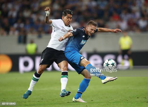 Pavel Kaderabek of Hoffenheim and Roberto Firmino of Liverpool during the UEFA Champions League Qualifying PlayOffs Round First Leg match between...