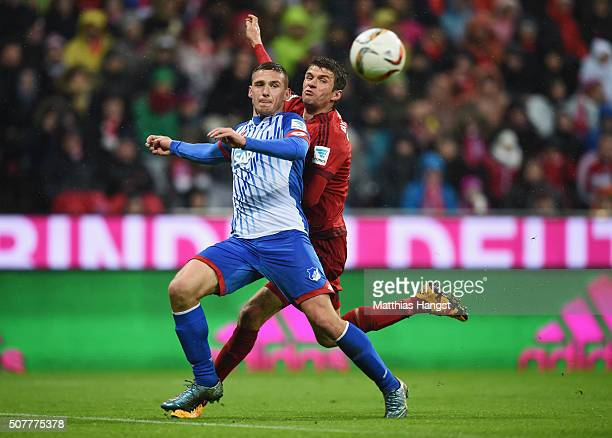 Pavel Kaderabek of Hoffenheim and Thomas Mueller of Bayern Munich chase the ball during the Bundesliga match between FC Bayern Muenchen and 1899...