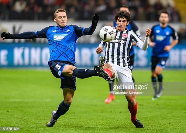 Pavel Kaderabek of Hoffenheim challenges Jesus Vallejo of Frankfurt during the Bundesliga match between Eintracht Frankfurt and TSG 1899 Hoffenheim...