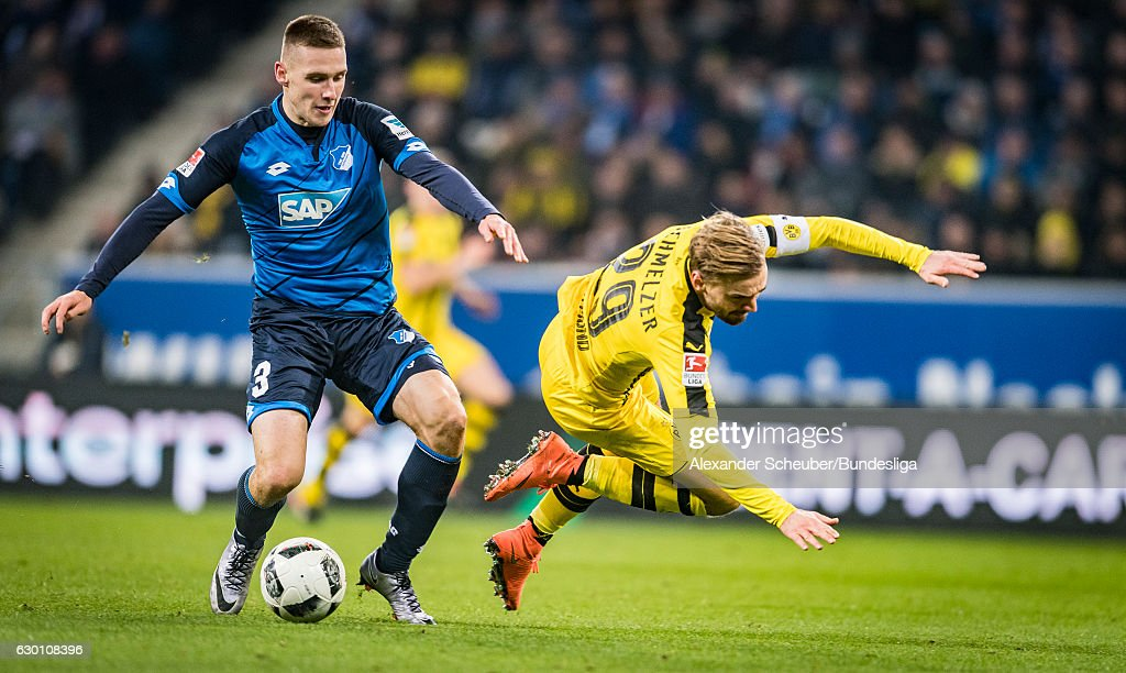 Pavel Kaderabek of Hoffenheim challenges Marcel Schmelzer of Dortmund during the Bundesliga match between TSG 1899 Hoffenheim and Borussia Dortmund at Wirsol Rhein-Neckar-Arena on December 16, 2016 in Sinsheim, Germany.