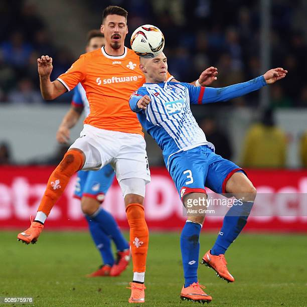 Pavel Kaderabek of Hoffenheim is challenged by Sandro Wagner of Darmstadt during the Bundesliga match between 1899 Hoffenheim and SV Darmstadt 98 at...