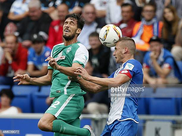 Pavel Kaderabek of Hoffenheim jumps for a header with Santiago Garcia of Bremen during the Bundesliga match between 1899 Hoffenheim and SV Werder...