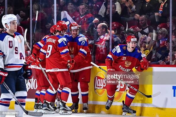 Pavel Karnaukhov of Team Russia celebrates a goal by teammate Denis Guryanov in the second period during the 2017 IIHF World Junior Championship...