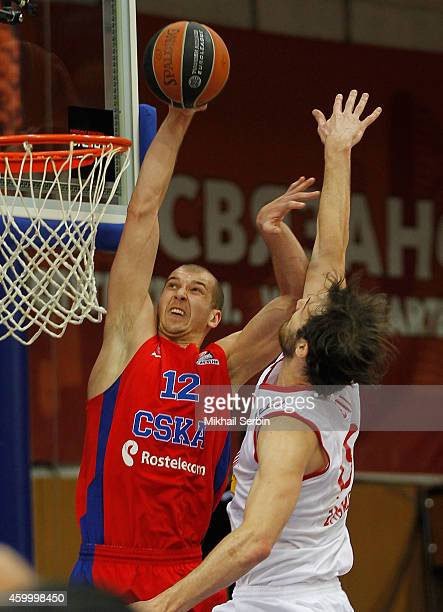 Pavel Korobkov #12 of CSKA Moscow competes with Miro Bilan #15 of Cedevita Zagreb in action during the 20142015 Turkish Airlines Euroleague...