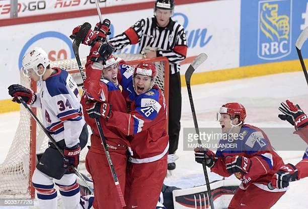 Pavel Kraskovski Yegor Korshkov and Alexander Polunin of Russia celebrate during the 2016 IIHF World Junior Ice Hockey Championship semifinal match...