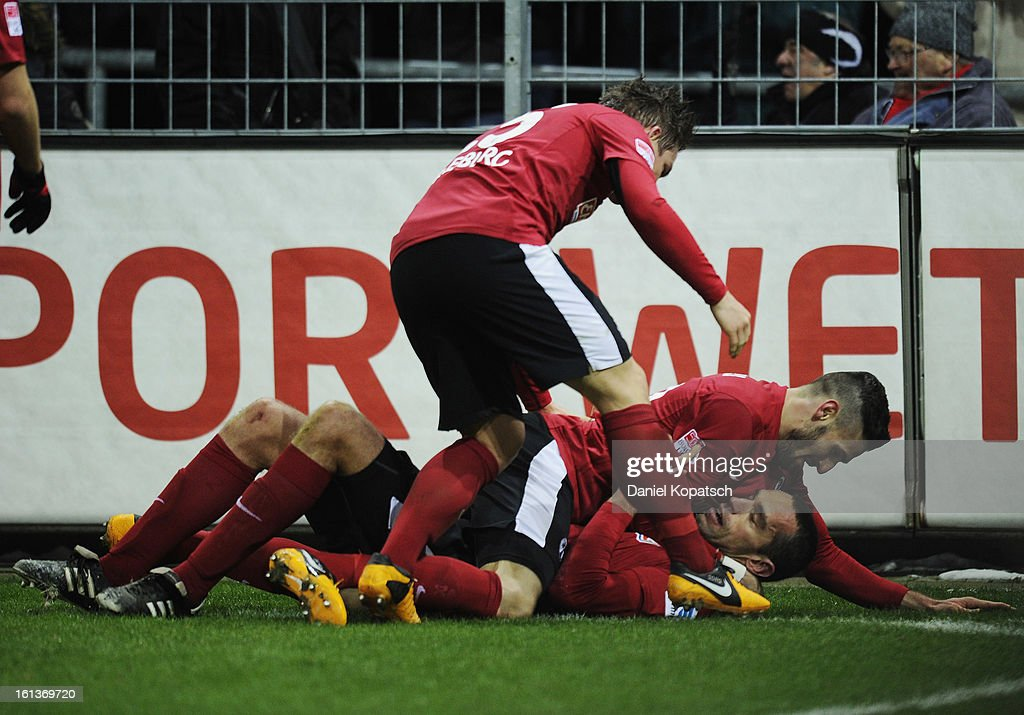 Pavel Krmas of Freiburg (C) celebrates his team's first goal with team mates Oliver Sorg (L) and Daniel Caligiuri during the Bundesliga match between SC Freiburg and Fortuna Duesseldorf 1895 at MAGE SOLAR Stadium on February 10, 2013 in Freiburg im Breisgau, Germany.